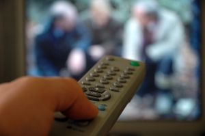 remote control being used to watch TV
